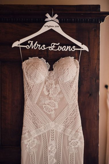 Structured Bustier Rue de Seine Fox Gown with Floral Appliqué Detail and Off The Shoulder Straps | Personalised Dress Hanger | Rue de Seine Wedding Dress with Pronovias Overskirt, Personalised Place Setting Illustrations and Sweetheart Table | Samuel Docker Photography