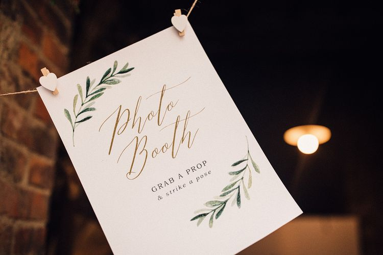 Photo Booth Sign | Wedding Reception at Il Rigo Agriturismo, Tuscany | Rue de Seine Wedding Dress with Pronovias Overskirt, Personalised Place Setting Illustrations and Sweetheart Table | Samuel Docker Photography