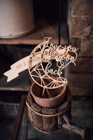 Wooden Photobooth Props | Wedding Reception at Il Rigo Agriturismo, Tuscany | Rue de Seine Wedding Dress with Pronovias Overskirt, Personalised Place Setting Illustrations and Sweetheart Table | Samuel Docker Photography