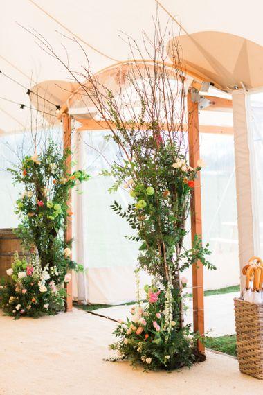 Tall Flower Arrangement Entrance to PapaKåta Sperry Tent Wedding