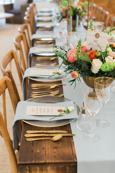 Wooden Reception Tablescapes with Glass Platters & Goblets & Gold Cutlery Place Settings