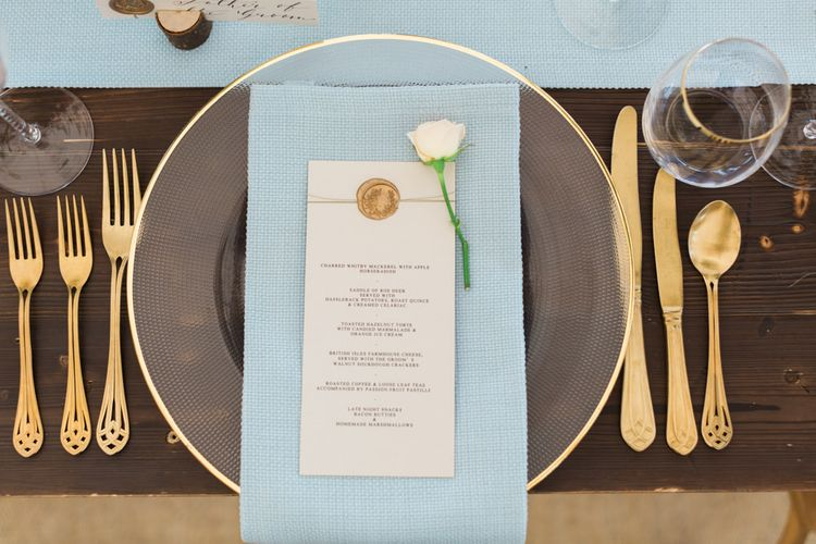 Pretty Glass Platter & Gold Cutlery Place Setting with Blue Linen Napkin.