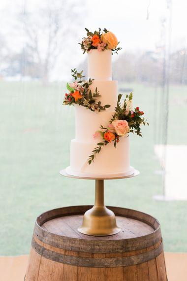 Three Tier Wedding Cake with Coral and Peach Wedding Flower Decor
