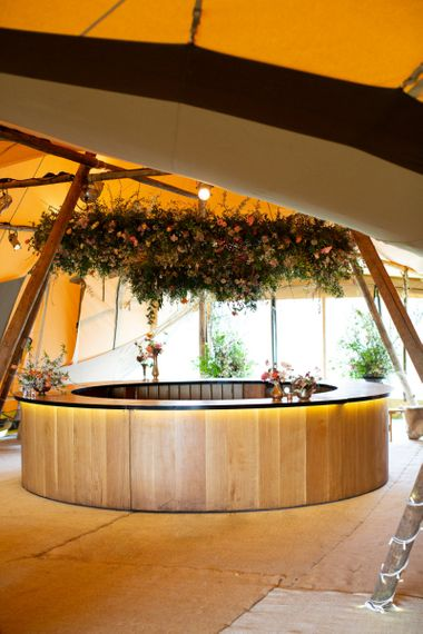 Wooden Bar with Floral Hoop Wedding Decor