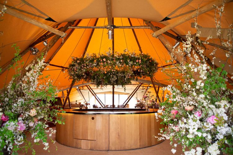Circular Bar with Floral Hoop Canopy and Floral Arrangements