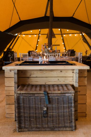 Wooden Fire pit within a PapaKåta Giant Teepee