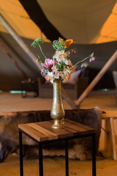 Gold Vessel Filled with Blush Flower Stems