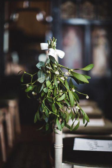 Hanging Mistletoe on Wedding Aisle Ends