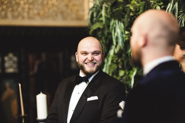 Groom Smiling at his Groom During The Wedding Ceremony