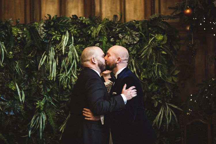 Groom & Groom Just Married Kissing During The Wedding Ceremony