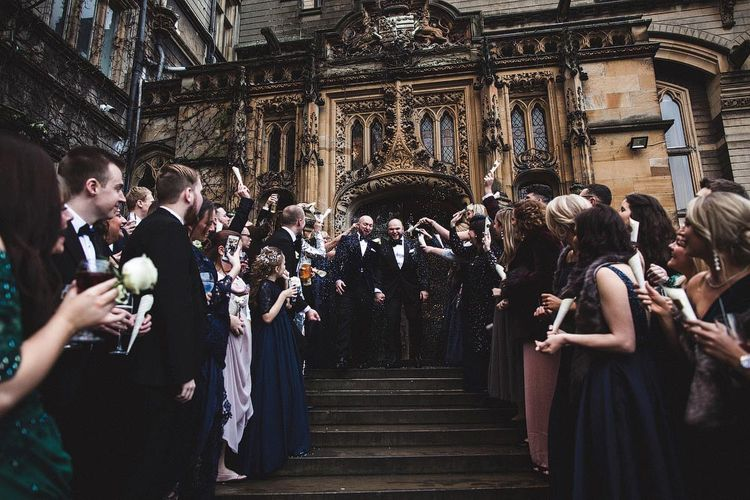 Groom & Groom Walking Down Carlton Towers Steps During Confetti Moment