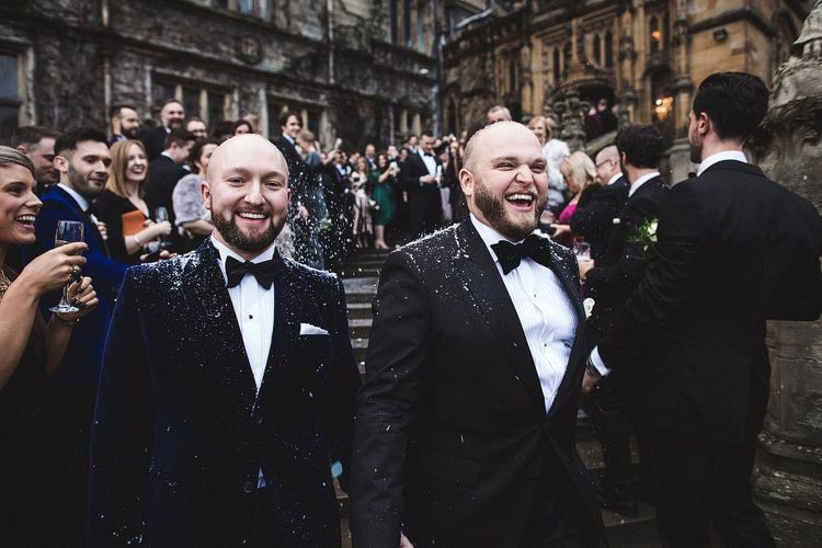 Smiling Groom & Groom in Tuxedo's During Confetti Moment