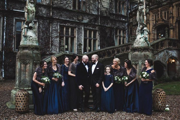 Groom and Groom and Bridesmaids in Navy Ball Gown Dresses and Faux Fur Stoles