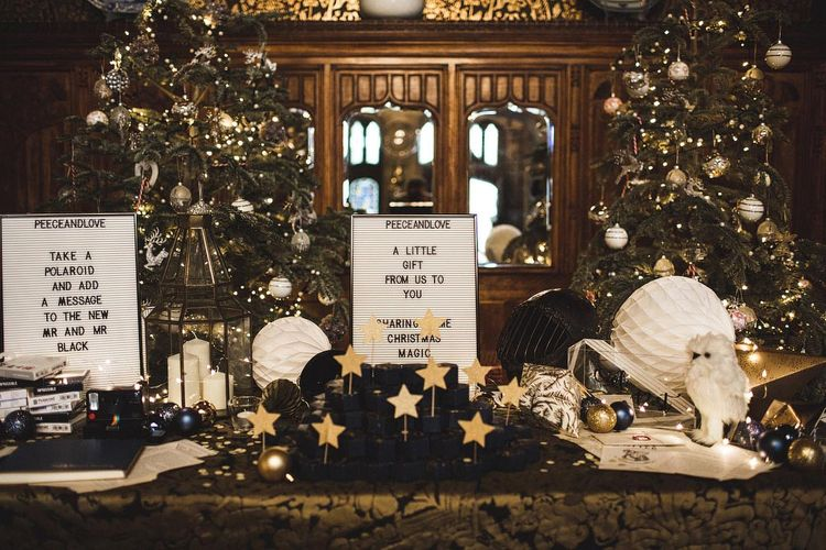 Wedding Favour Table with Peg Board Signs and Christmas Tree Backdrops