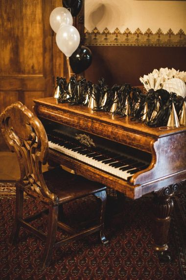 Piano with Gold & Black Christmas hats