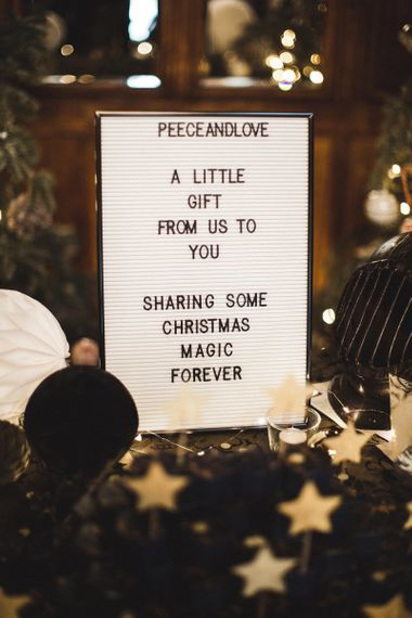 White and Black Peg Board Wedding Sign