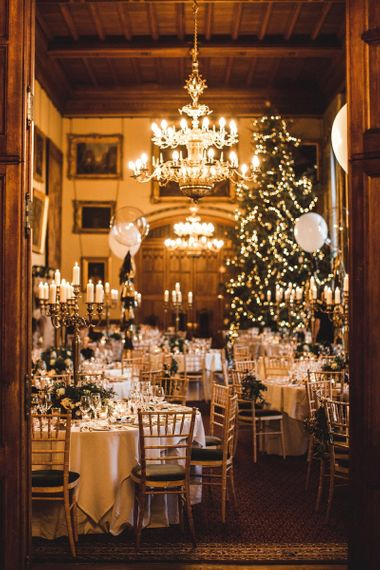 Christmas Wedding Reception Decor with Christmas Tree and Candelabra Centrepieces