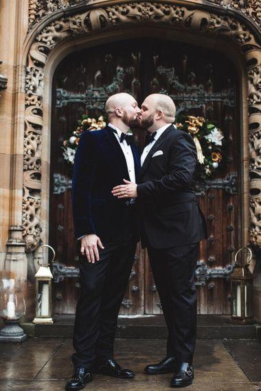 Groom and Groom Kissing in Black Tuxedo's