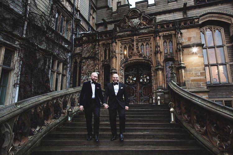 Groom & Groom Walking Down Carlton Towers Steps
