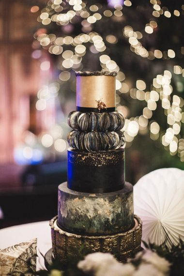 Elegant Five Tier Black and Gold Wedding Cake by Nice Icing