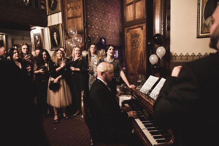 Wedding Guests Enjoying a Sing Song at The Piano