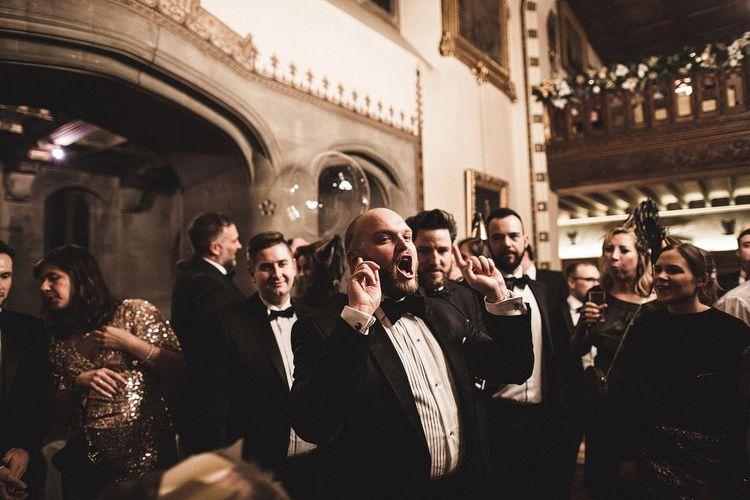 Groom Singing Christmas Carols During Winter Wedding