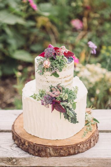 Two Tier Ice Wedding Cake with Flower Decor on a Tree Slice by Clare Makes Cakes | Whimsical De Winton Paper Co. Wedding Stationery Suite | Pastel Peter Rabbit Spring Inspiration at River Cottage | Beatrix Potter | Mr McGreagor's Garden | Succulent Vegetables & Flowers | Jennifer Jane Photography