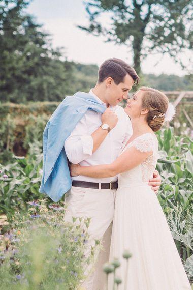Bride in Lace Wedding Dress with Back Detail | Groom in Pale Blue Jacket & Chino's | Pastel Peter Rabbit Spring Inspiration at River Cottage | Beatrix Potter | Mr McGregor's Garden | Jennifer Jane Photography