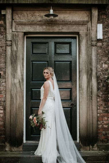 Phase Eight wedding dress with shimmering sequin detail and half draped back