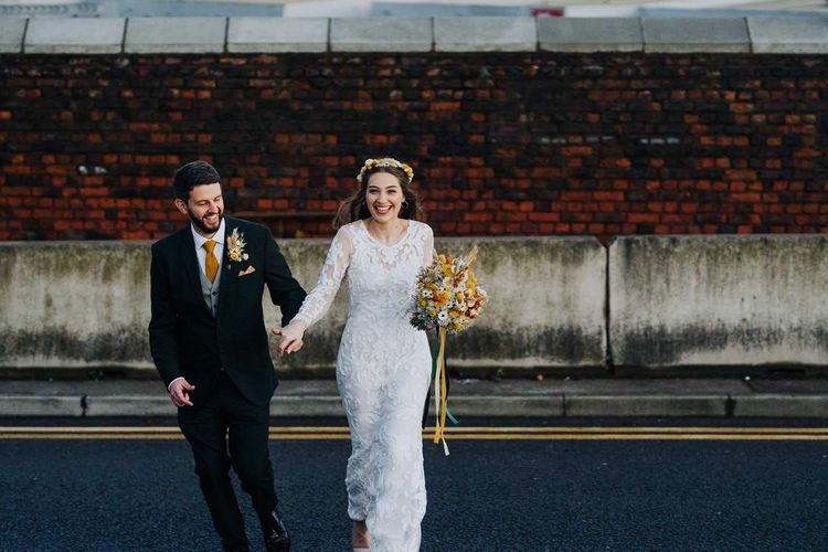 Phase Eight wedding dress with appliqué detail overskirt and long sleeves