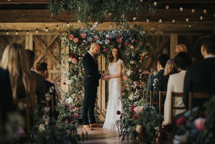 Humanist Wedding Ceremony | Floral Arch | Bride in Lace Lusan Mandongus Wedding Dress | Groom in Navy Marc Darcy Three-Piece  Suit | Vintage Dewsall Court Wedding | Kerry Diamond Photography