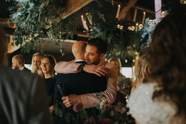 Guests Hugs | Groom in Navy Marc Darcy Three-Piece  Suit | Vintage Dewsall Court Wedding | Kerry Diamond Photography