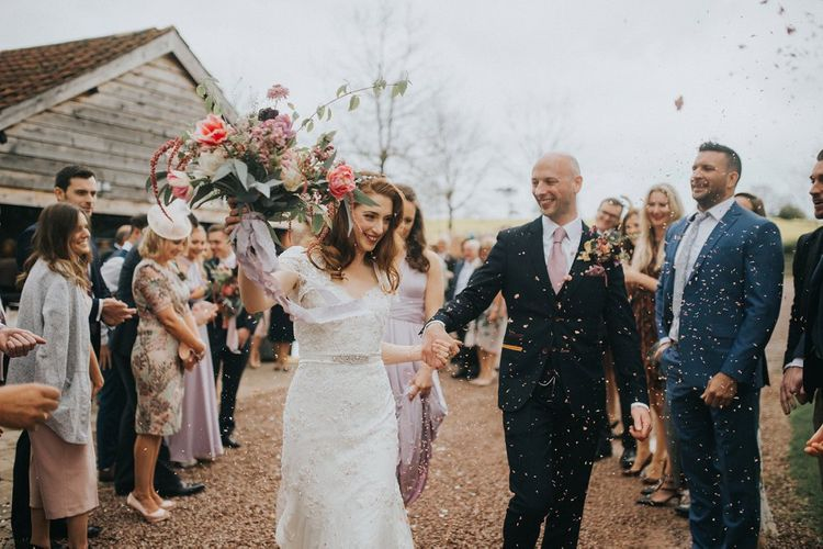 Confetti Exit | Bride in Lace Lusan Mandongus Wedding Dress | Groom in Navy Marc Darcy Three-Piece  Suit | Vintage Dewsall Court Wedding | Kerry Diamond Photography