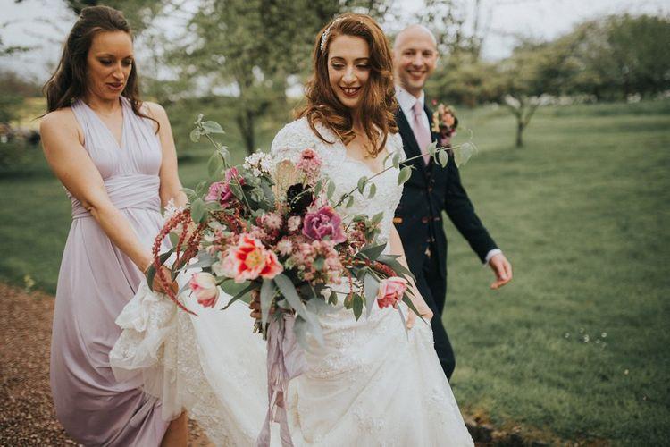 Oversized Bridal Bouquet | Bride in Lace Lusan Mandongus Wedding Dress | Vintage Dewsall Court Wedding | Kerry Diamond Photography
