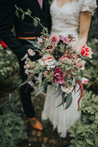 Wild Flower Bouquet | Bride in Lace Lusan Mandongus Wedding Dress | Vintage Dewsall Court Wedding | Kerry Diamond Photography