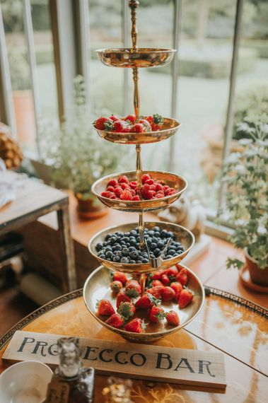Pimp Your Prosecco Bar | Berries on Cake Stand | Vintage Dewsall Court Wedding | Kerry Diamond Photography