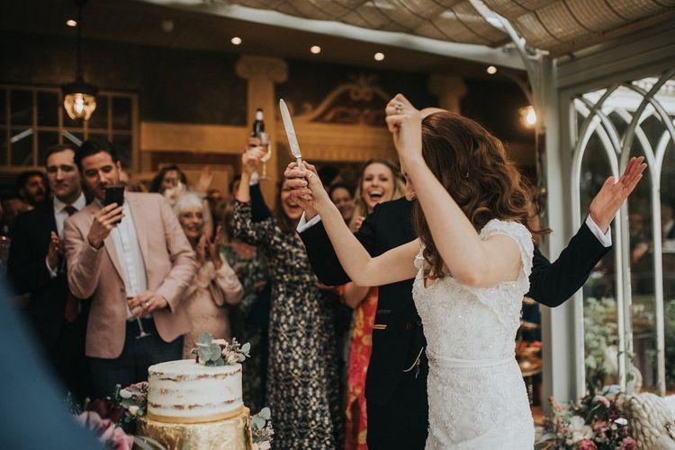 Cutting the Wedding Cake | Vintage Dewsall Court Wedding | Kerry Diamond Photography