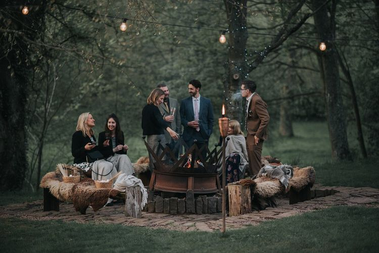 Wedding Guests at Firepit | Vintage Dewsall Court Wedding | Kerry Diamond Photography