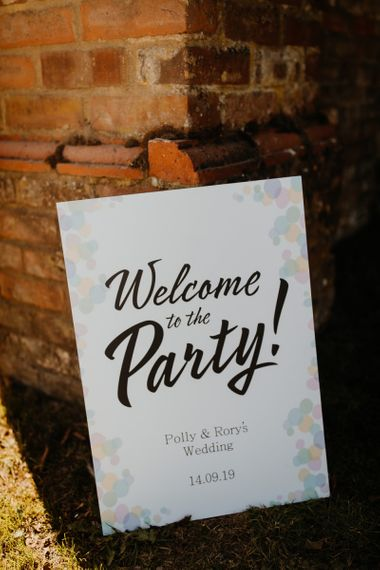 Personalised wedding sign with colourful hanging lanterns decor