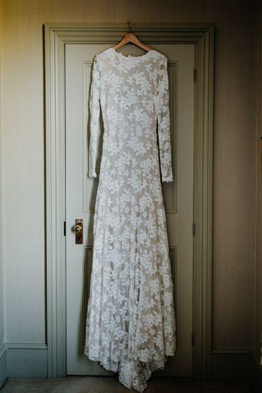 Laced long sleeve bridal dress at village hall wedding in Kent