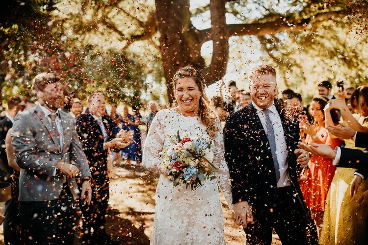 Colourful confetti at village hall wedding in Kent