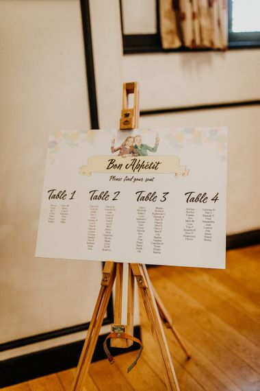 Personalised table plan with caricature illustration and colourful hanging lanterns