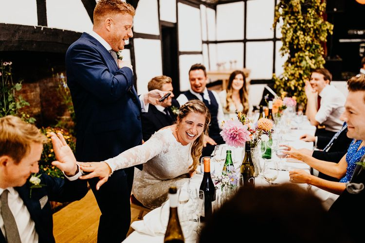 Grooms speech at wedding reception with colourful styling and hanging lanterns