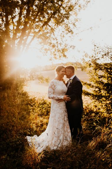 Bride and groom steal a moment for some golden hour shots