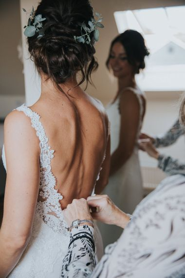 Wedding Morning Bridal Preparations with Bride in Lace Low Back Wedding Dress