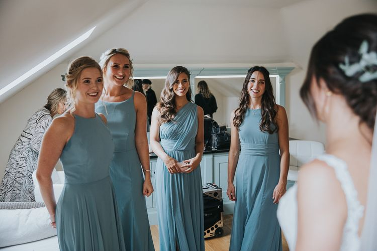 Bridesmaids First Glimpse of the Bride wearing Different Green Dessy Dresses
