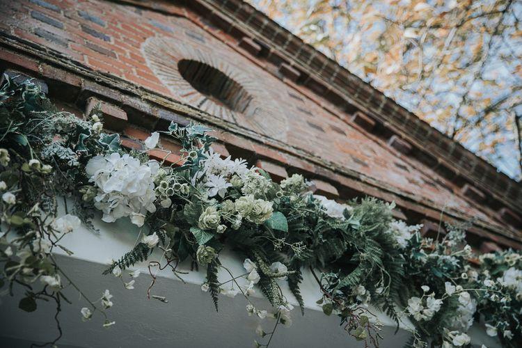 Foliage and White Floral Arrangement