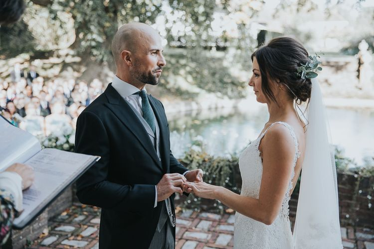 Bride and Groom Exchanging Vows and Giving Rings During the Wedding Ceremony
