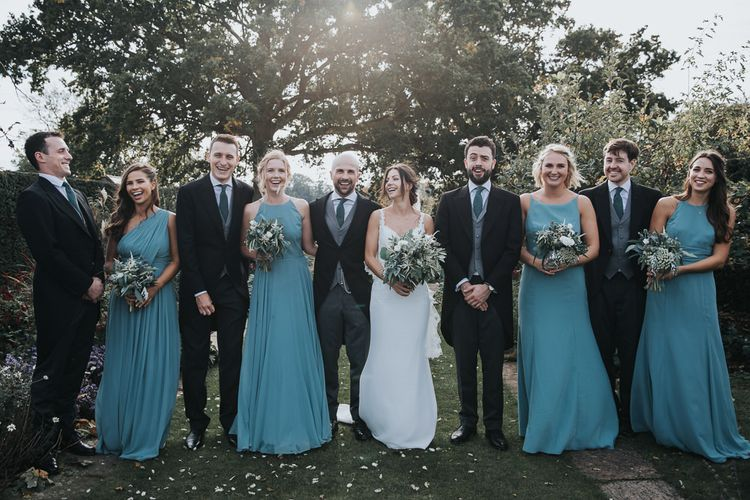 Wedding Party Portrait in Traditional Tails and Green Dessy Dresses