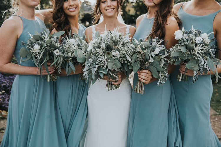 Bride and Bridesmaid Bouquets with Foliage and White Flowers